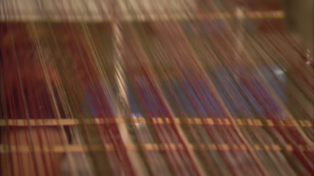 a woman operates a loom. - loom stock videos & royalty-free footage