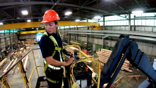 woman operating the crane in the factory - safety equipment stock videos & royalty-free footage