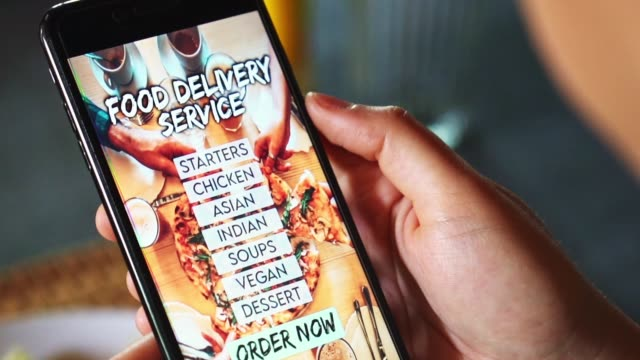 woman ordering food with a food delivery service - menu stock videos & royalty-free footage