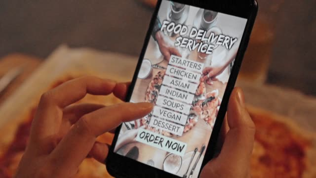 woman ordering food with a food delivery service - lunch stock videos & royalty-free footage