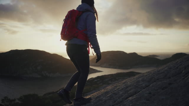 woman outdoor adventures: hiking in norway, on the mountain by a fjord - rucksack stock videos & royalty-free footage