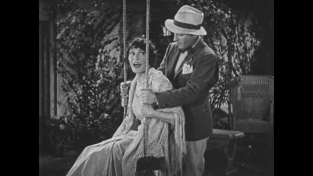 1932 a woman overhears her impersonator making future plans with her man (bing crosby) - 盗み聞き点の映像素材/bロール