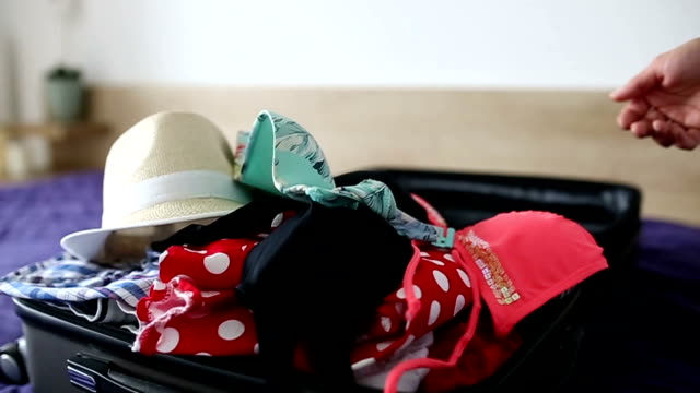 woman packing for a trip - suitcase stock videos & royalty-free footage