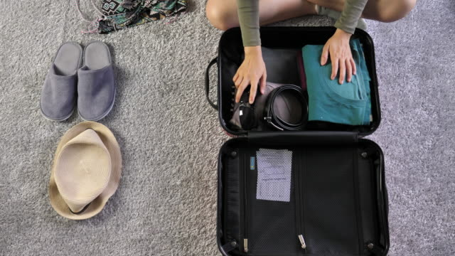 woman packing suitcase for vacation - sunglasses stock videos & royalty-free footage