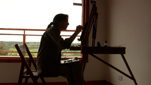 Woman painting backligting