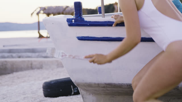 ds woman painting her boat - dry dock stock videos & royalty-free footage