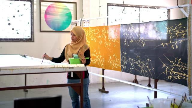 woman painting in a batik workshop - batik stock videos & royalty-free footage