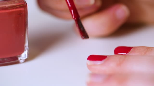"cu woman painting nails red - ""bbc universal"" stock videos & royalty-free footage"
