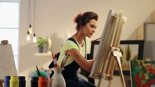 ms woman painting on canvas at home / delhi, india - painting stock videos & royalty-free footage
