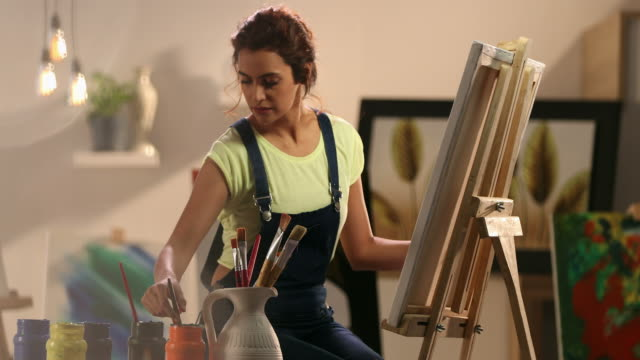ms woman painting on canvas at home / delhi, india - image stock videos & royalty-free footage