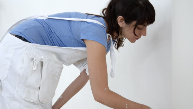 ms woman painting wall / london, england, united kingdom - house painter stock videos and b-roll footage