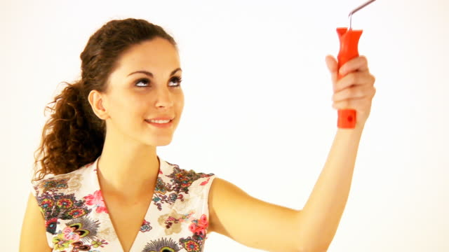 HD: Woman painting with paint roller