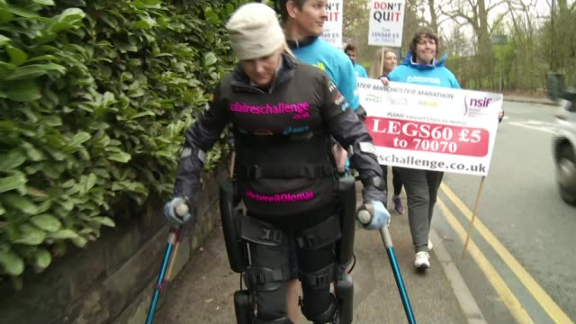 Woman paralysed from the chest down completes the Manchester Marathon ENGLAND Manchester EXT Various of Claire Lomas along with crutches as people...