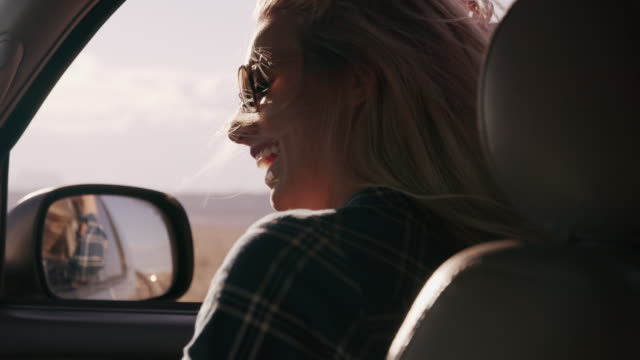 woman passenger in car enjoying wind blowing hair / hanksville, utah, united states - land vehicle stock videos & royalty-free footage