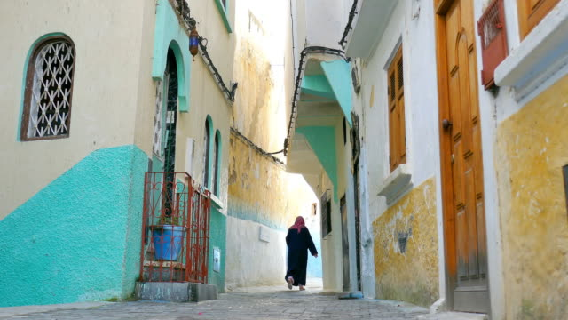 Woman Passing Though on the Streets of Morocco