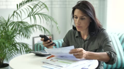 woman paying bill on smart phone, mobile payment - document stock videos & royalty-free footage