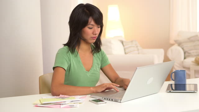 woman paying bills with laptop computer - natürliches haar stock-videos und b-roll-filmmaterial