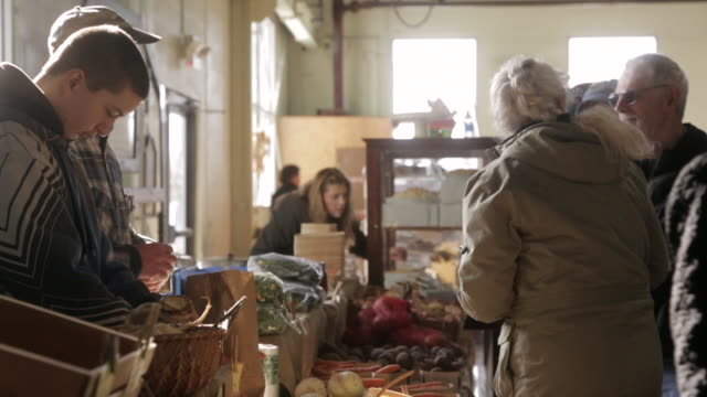 ms woman paying for produce in vermont farmers market / rutland, vermont, united states - retail place stock videos & royalty-free footage