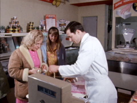 a woman pays for groceries in a supermarket 1968 - cash register stock videos and b-roll footage