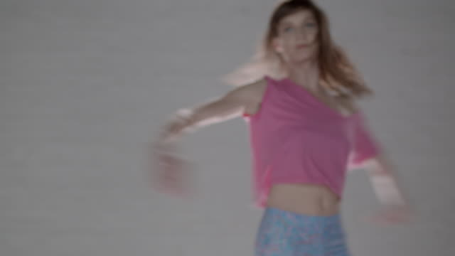 woman performing a pirouette and reaching out towards camera - pirouette stock videos and b-roll footage