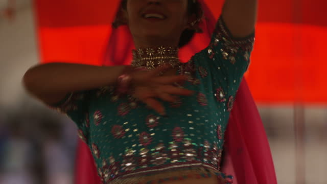 woman performing an Indian dance for Holi