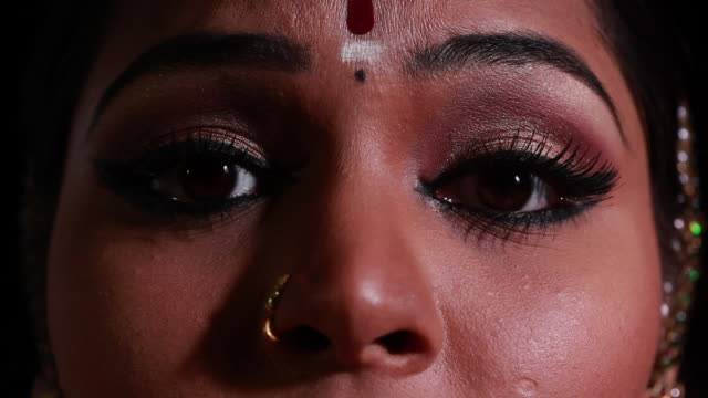 woman performing bharatanatyam dance on the stage  - bindi stock videos and b-roll footage