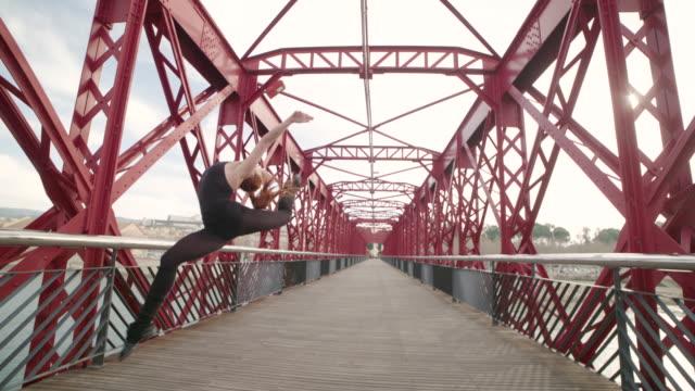 Woman performing gymnast rhythmic jump