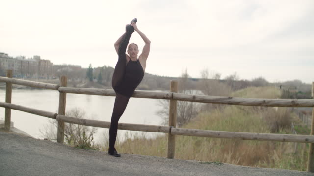 woman performing gymnast rhythmic position at outdoors - doing the splits stock videos & royalty-free footage