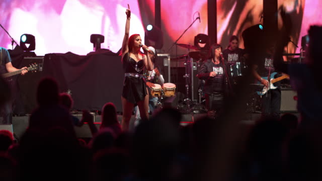 DS Woman performing on stage in a concert at night