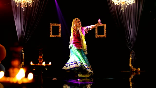 ms woman performing traditional ghoomar dance on stage/ india - カーテン止め点の映像素材/bロール