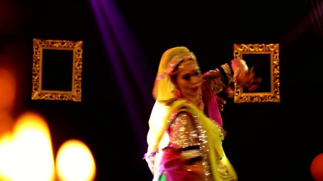 vídeos y material grabado en eventos de stock de ms woman performing traditional ghoomar dance on stage/ india - encuadre de tres cuartos