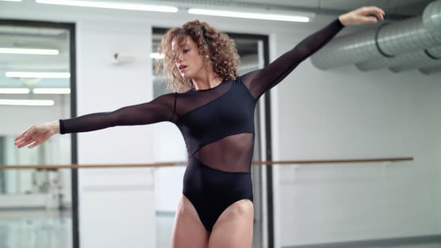 woman performs modern dance in a dance studio / dance teacher / professional dancer - dance studio stock videos and b-roll footage
