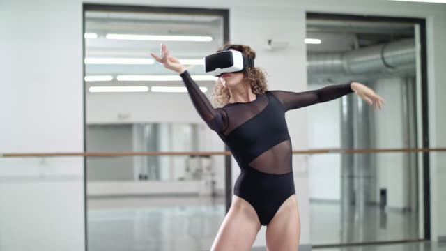 woman performs modern dance in a dance studio while using a vr headset (virtual reality) - ballet dancing stock videos & royalty-free footage