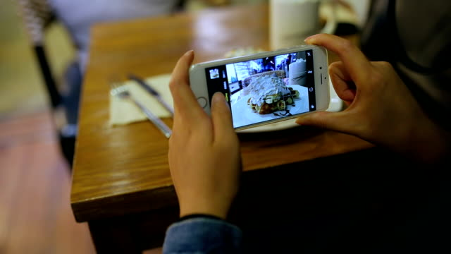 woman photographing food with smart phone - photographing stock-videos und b-roll-filmmaterial