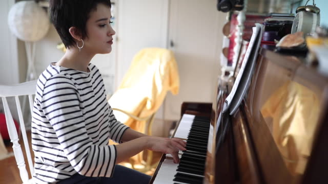 woman pianist playing piano in her room at home - soloist stock videos & royalty-free footage