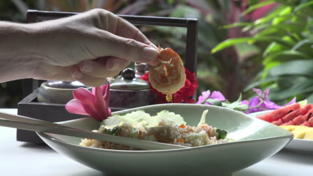 woman pick up shrimp from fried rice - fried rice stock videos and b-roll footage