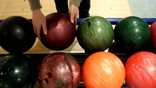 woman picking ball for bowling,close up - ten pin bowling stock videos & royalty-free footage