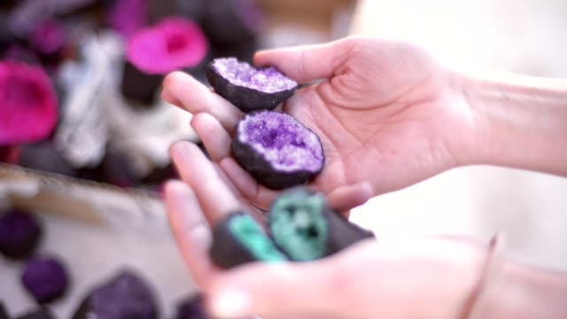 Woman picking geode crystals on old market