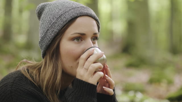 woman picking mushrooms and drinking coffee in the forest - picnic stock videos and b-roll footage