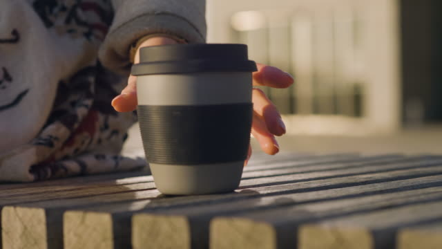 woman picking up a travel mug with coffee - cup stock videos & royalty-free footage