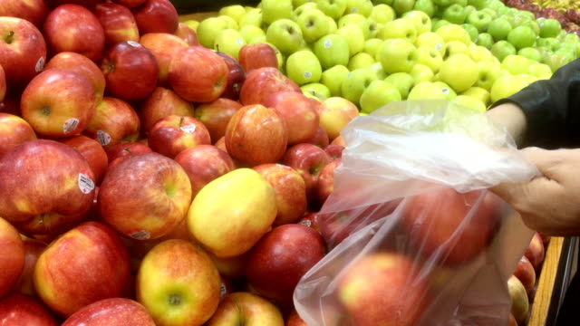 woman picking up apple - apple fruit stock videos & royalty-free footage