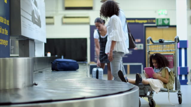 woman picking up luggage - luggage stock videos & royalty-free footage