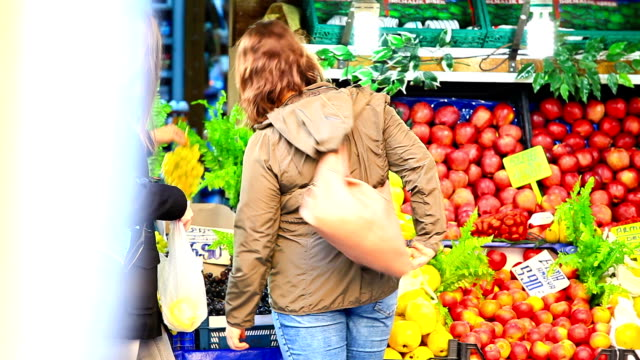 HD: Woman Picking Up Vegetables In Grocery Store