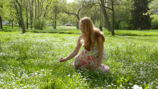 woman picks flower and walks away - sundress stock videos & royalty-free footage