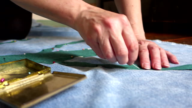 woman pinning pieces of textile to her tapestry - tapestry stock videos & royalty-free footage