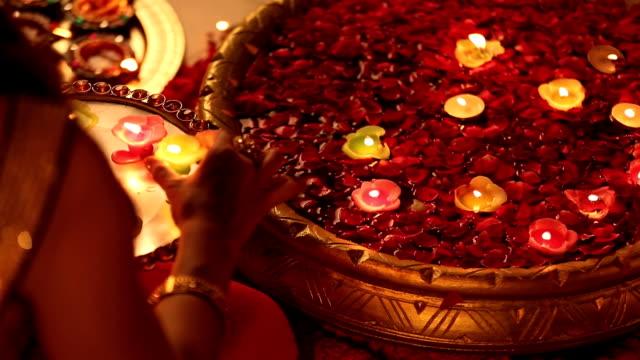 vídeos y material grabado en eventos de stock de ms ha woman placing diyas in bowl during diwali festival at home - bandeja para servir