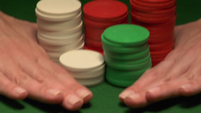 cu, woman placing gambling chips on gaming table, close-up of hands - croupier stock videos & royalty-free footage
