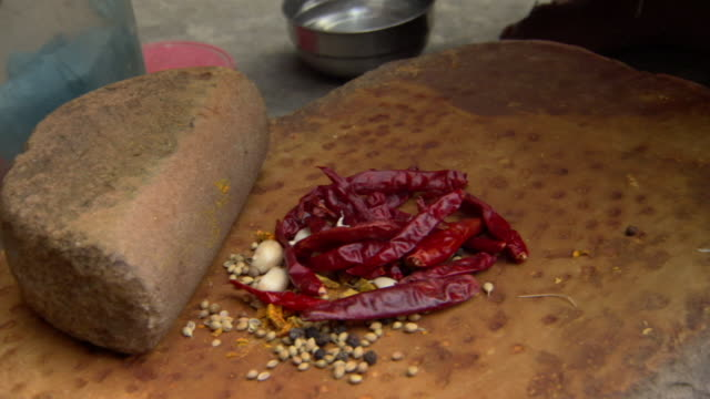 cu tu woman placing peppers and spices on stone and grinding with stone, agra, uttar pradesh, india - agra stock videos and b-roll footage