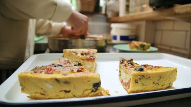 woman placing quiche - dishcloth stock videos & royalty-free footage