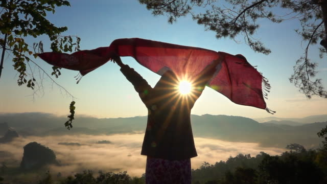 woman play scarf against sunrise on hill slow motion - scarf stock videos & royalty-free footage